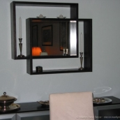 Added a mirror with shelves above the credenza