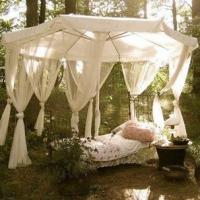 sleeping-under-a-gazebo-of-curtains