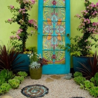 painted door colorful wall and plantings