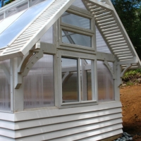 charming-contemporary-woods-greenhouse-exterior-design-use-transparent-window