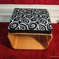 Black and white scroll cushion