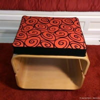 Red and black scroll cushion