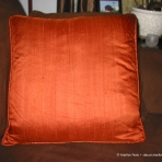 Orange silk pillow with piping