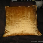 Tucked yellow silk pillow with piping