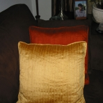 Yellow and orange silk pillows with piping