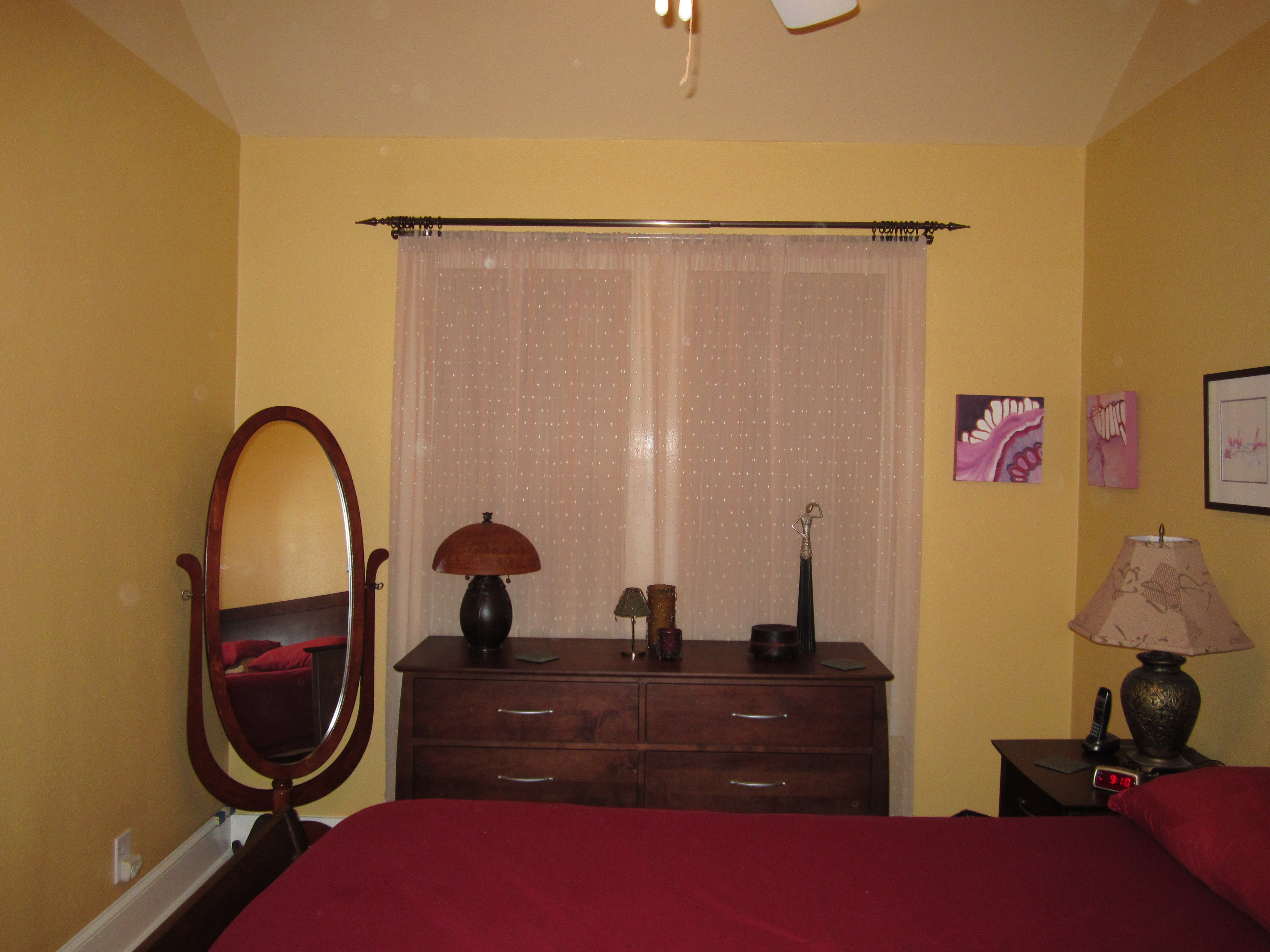 Bedroom after painting - window wall with sheers installed