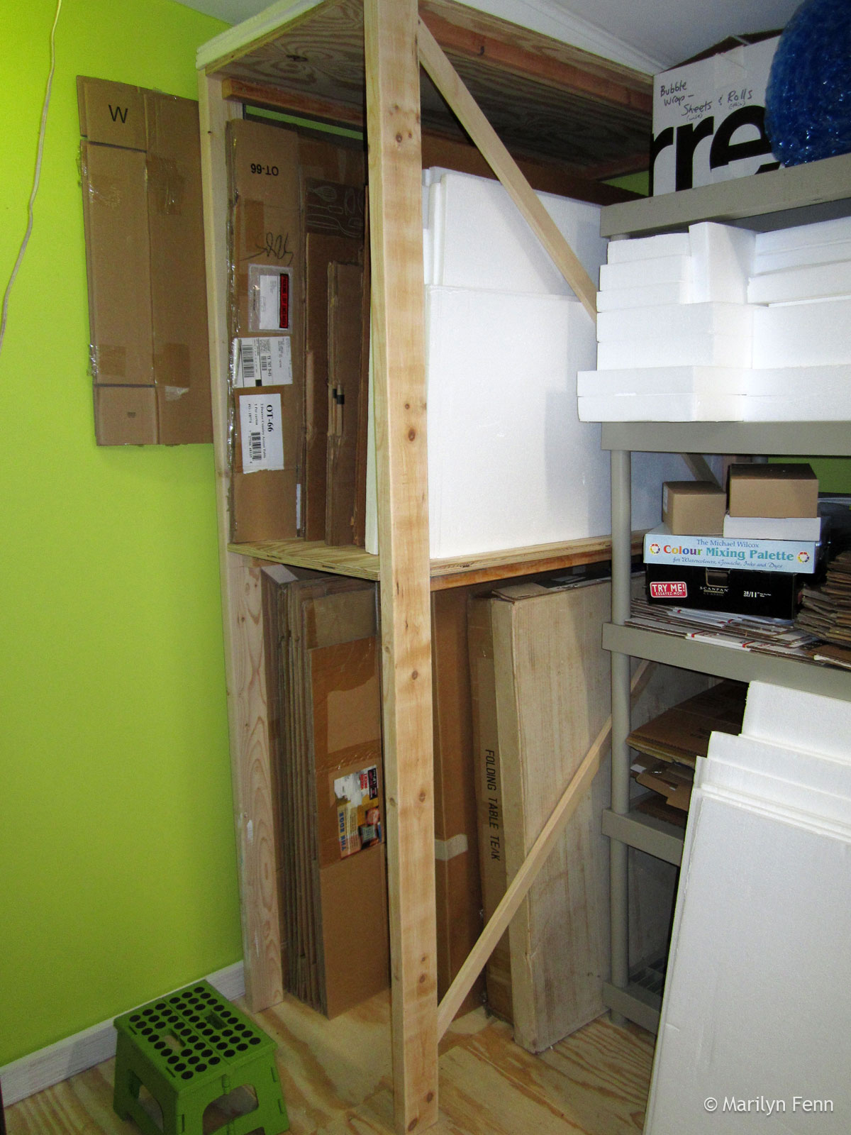 Box storage shelving completed and filled with even more stuff