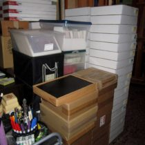 Boxes of encaustic paintings, art cards, giclee prints, canvases, and more