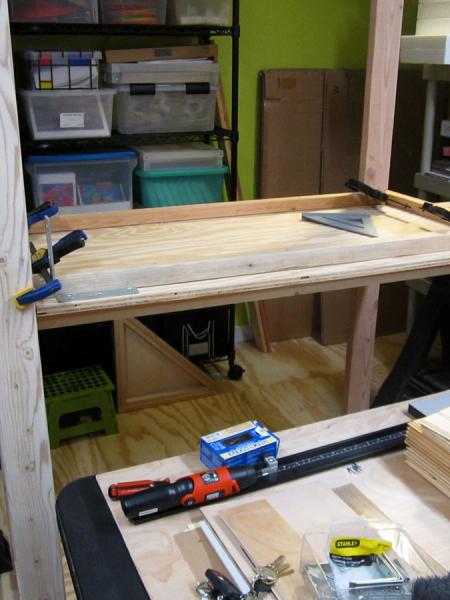 Building the box storage shelving unit - installing the middle shelf