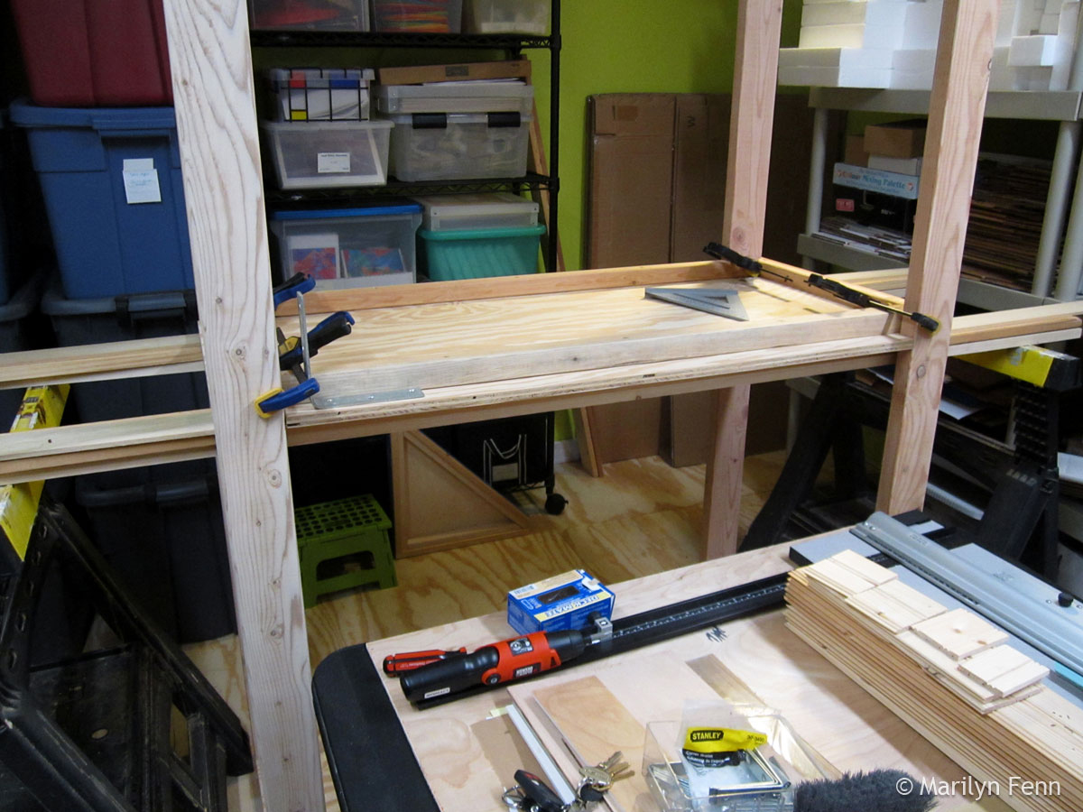 Building the box storage shelving unit - installing the middle shelf