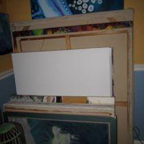 Large canvases and drawings stuffed in the dining room