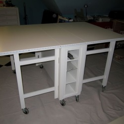 Love my new cutting-work-framing table that rolls around or folds down and out of the way