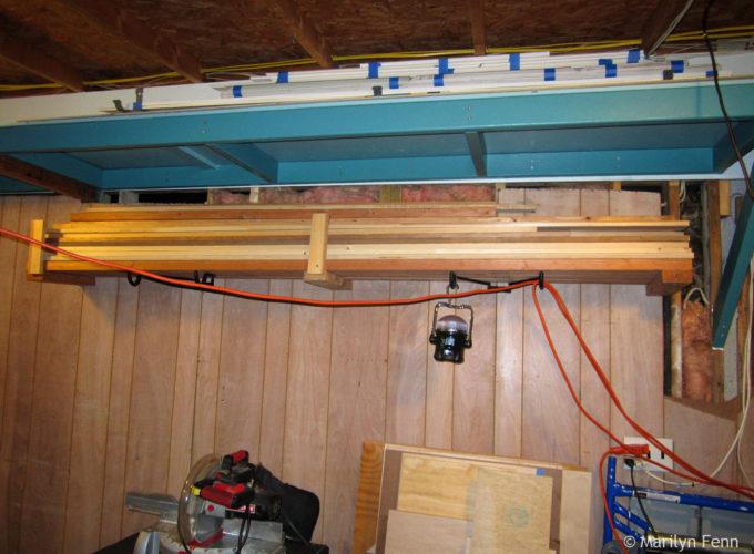 Molding storage above; dimensional lumber shelf below