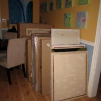 More large canvases and drawings stuffed in the dining room