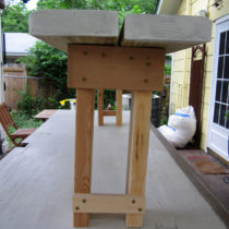 Narrow-stance garden bench – end view