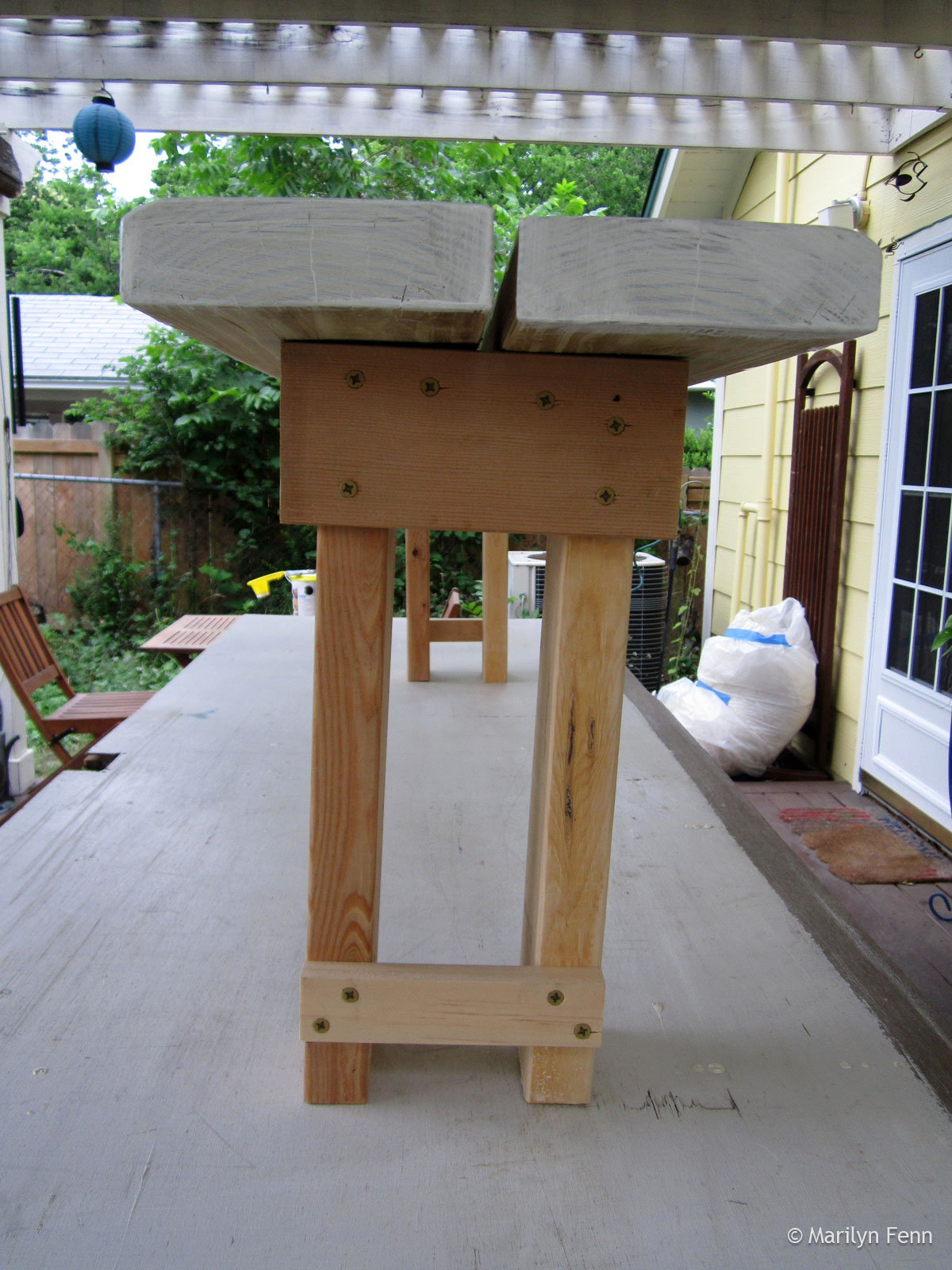 Narrow-stance garden bench - end view
