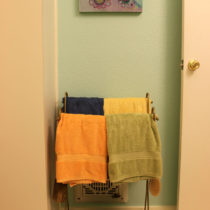 Our old towel rack with one of my paintings