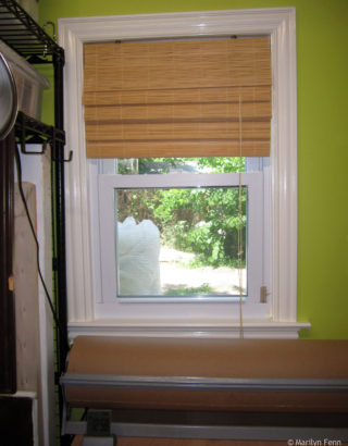 Window with trim and bamboo shade