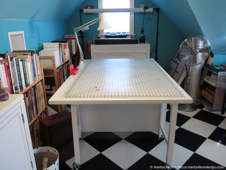 Collapsible cutting table with storage cubbies