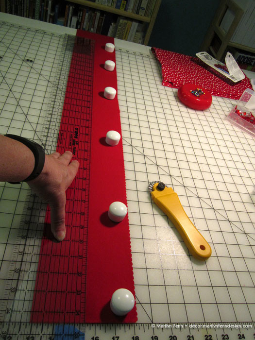 Cutting red fabric for chair cushion sides