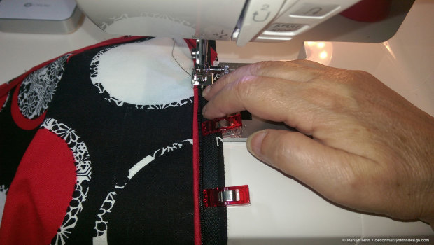 Stitch over right side zipper teeth using concealed zipper presser foot