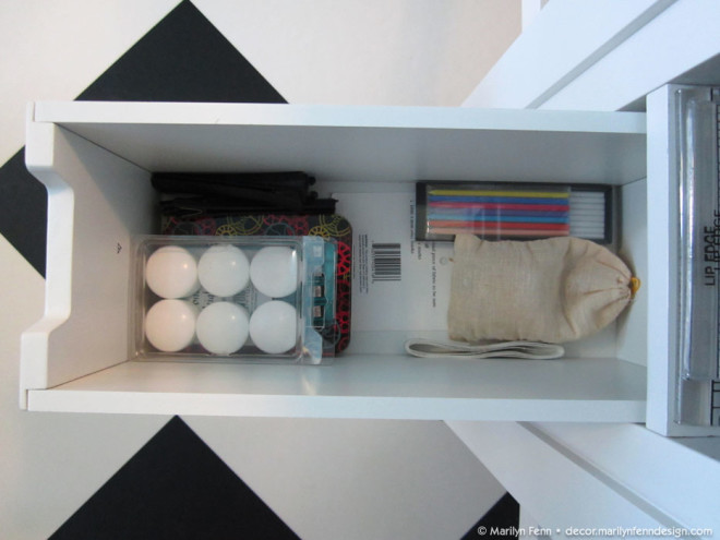 Storage drawer in cutting table